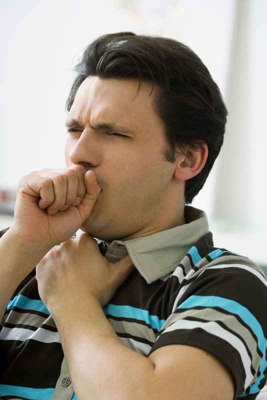 Photo of a man coughing