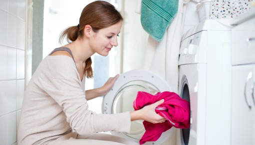 Photo of a woman doing laundry