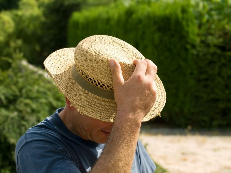 Photo of a man wearing a straw hat