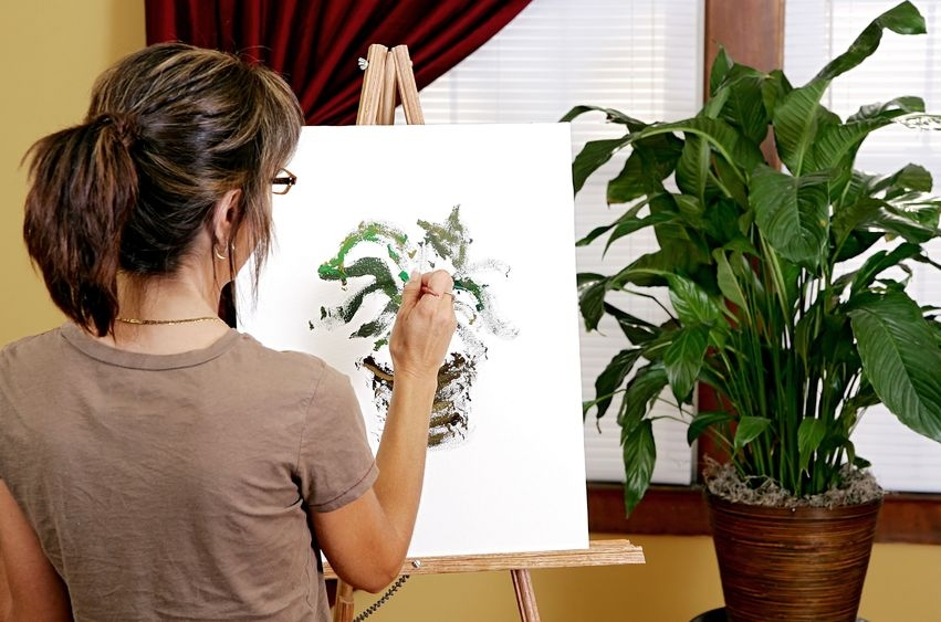 photo of woman painting a picture