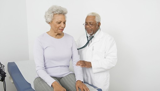 Photo of a patient being examined by a doctor