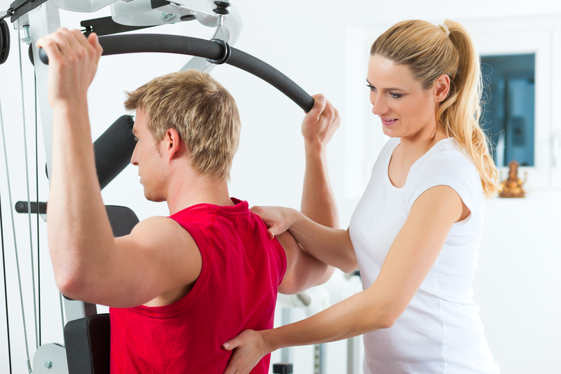 Photo of a patient doing back exercises with the help of a physiotherapist