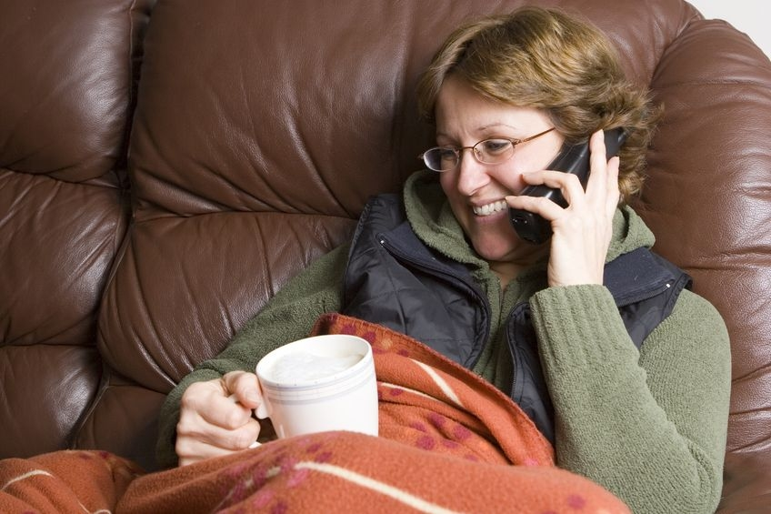 Photo of a woman on a sofa chatting on the phone