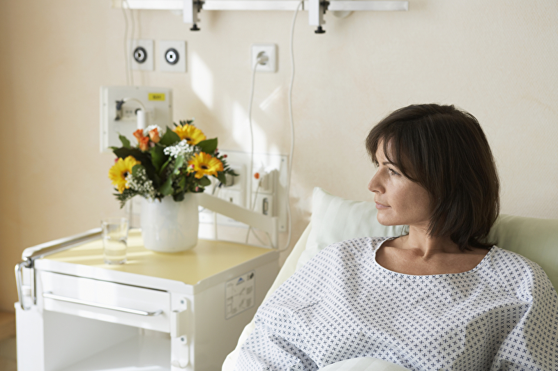 Photo of a woman in a hospital bed
