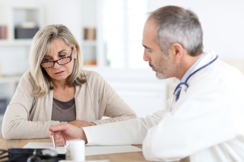 Photo of a doctor talking to a patient