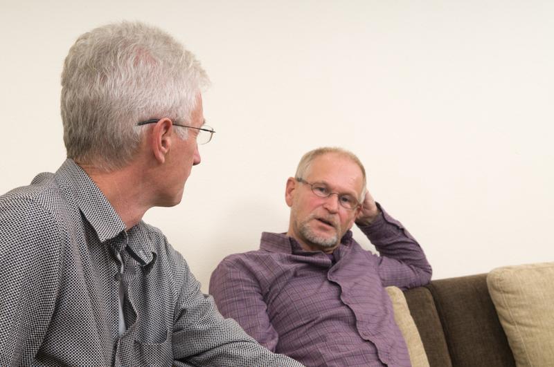 Photo of two men talking