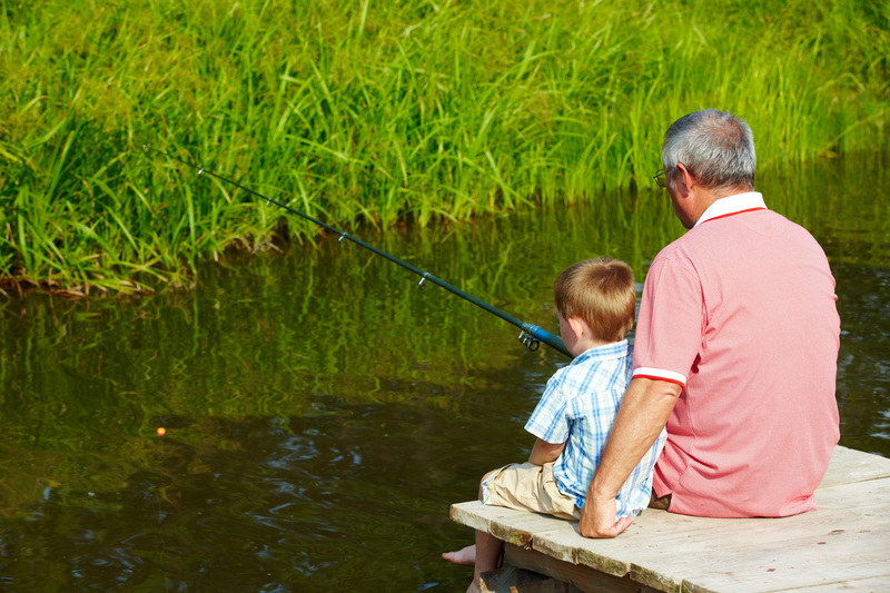 Photo of a man and boy fishing