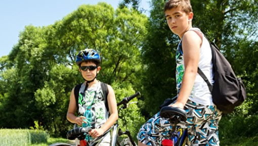 Photo of two boys on a bike ride