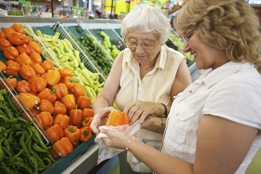 Photo of two women in the vegetable section of a supermarket