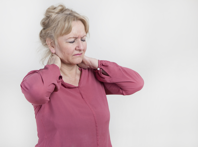 Photo of a woman with neck pain
