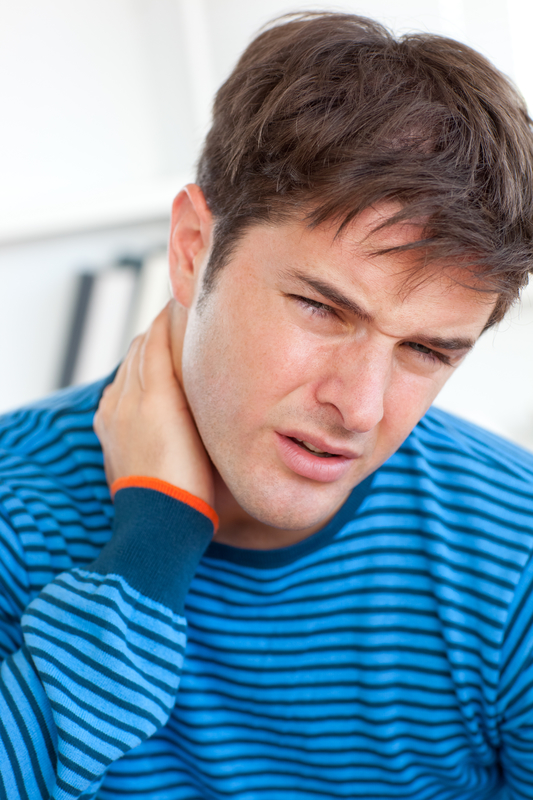 Photo of a man with a painful boil at the back of his neck