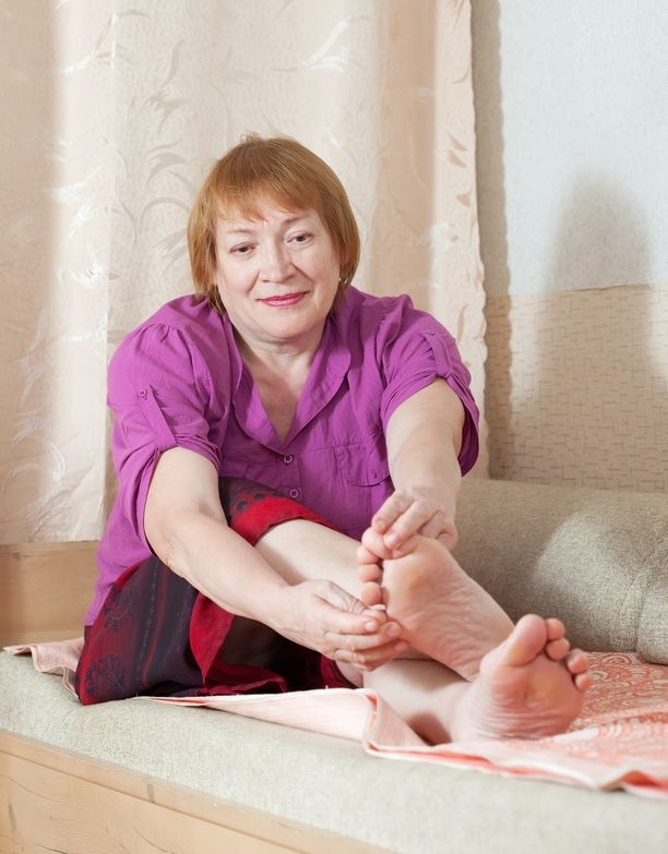 Photo of a woman looking at her toenails