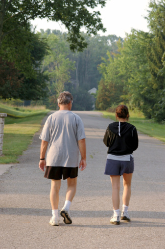 Photo of a couple coming back from jogging
