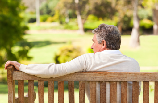 Photo of a man on a bench