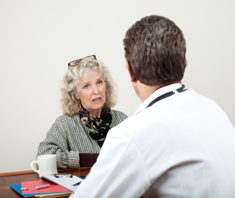 Photo of a woman talking with the doctor
