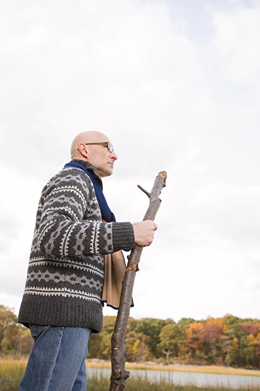 Photo of a bald man outdoors