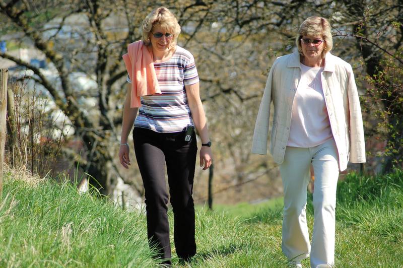 Photo of two women taking a walk