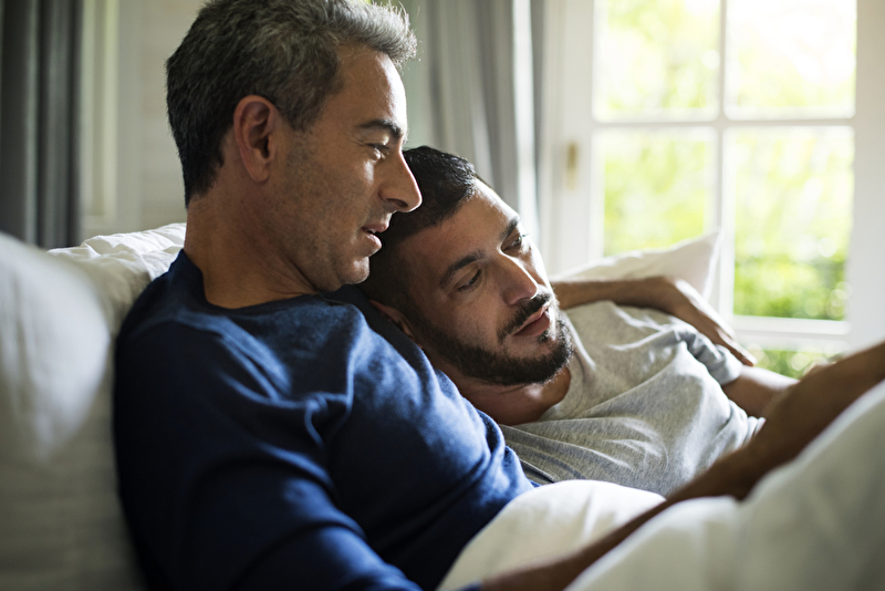 Photo of two men on a sofa