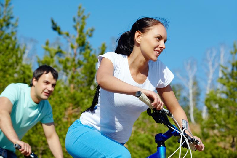 Photo of a couple riding bikes