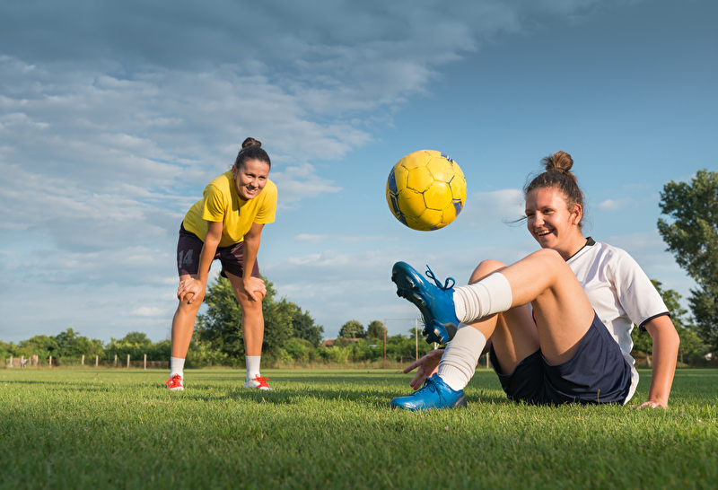 Photo of two women playing soccer