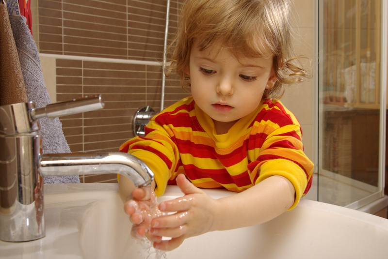 Photo of a child washing his hands