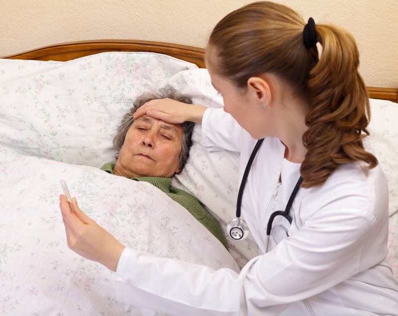Photo of a patient and doctor during a home visit