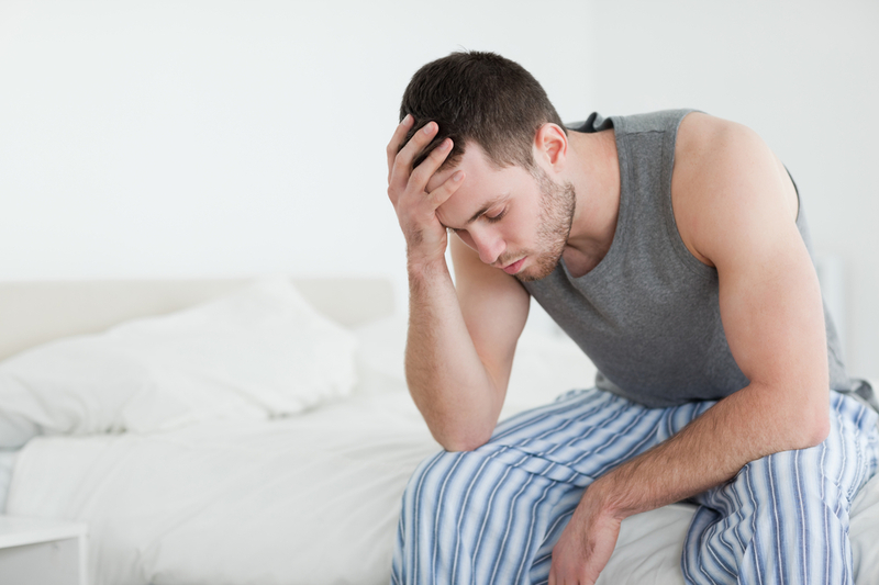 Photo of a man feeling unwell