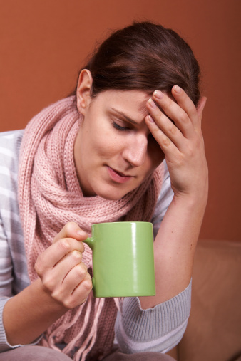 Photo of a woman with a sore throat