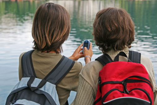 Photo of two boys by a lake