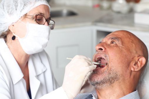 Photo of a dentist and patient