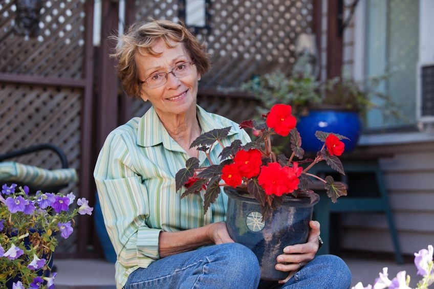 Photo of a woman holding flowers