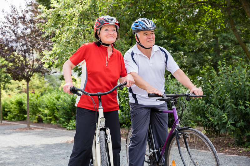 Photo of an older couple cycling