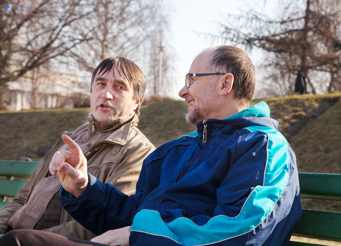 Photo of two men chatting