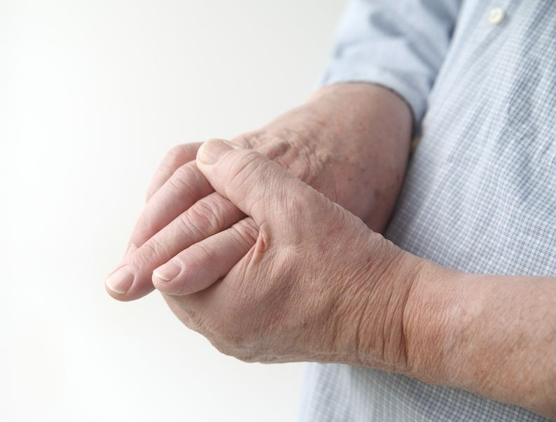 Photo of someone holding their hand in pain