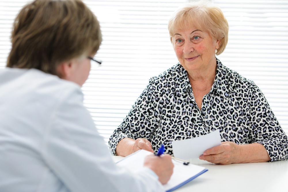 Photo of a patient talking with her doctor