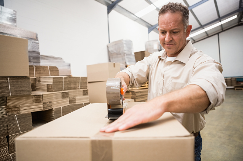 Photo of a man working in a warehouse