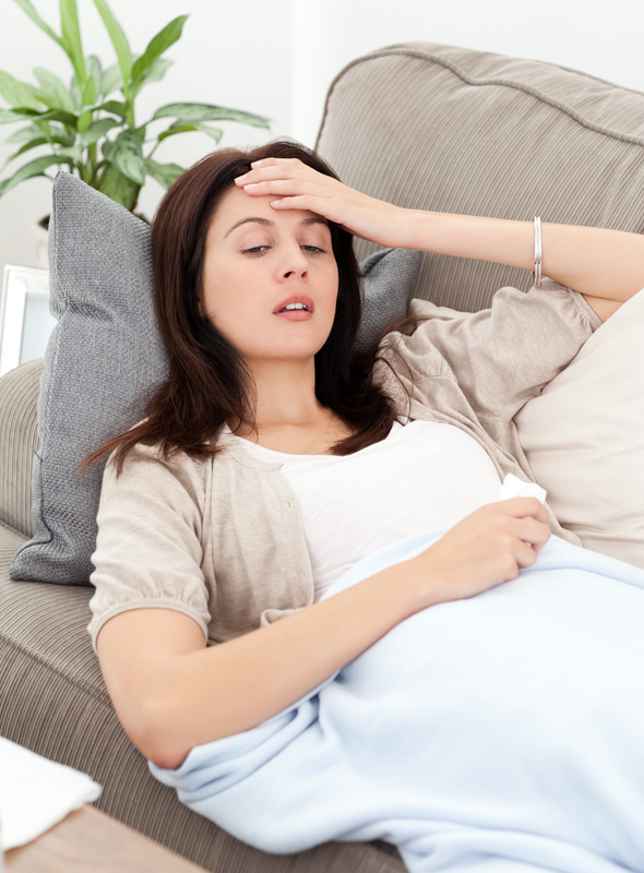 Photo of a pregnant woman with nausea