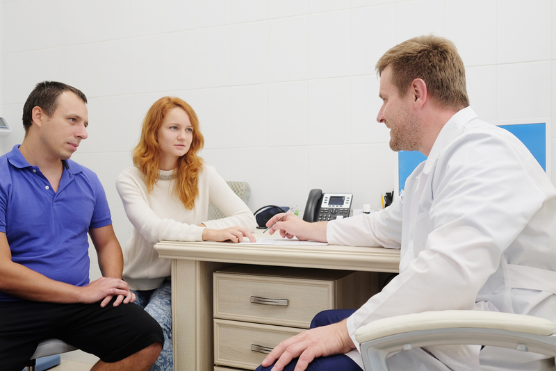 Photo of a couple talking with a doctor
