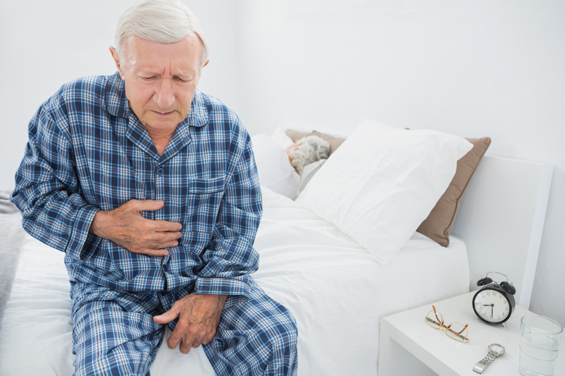 Photo of a man with heartburn