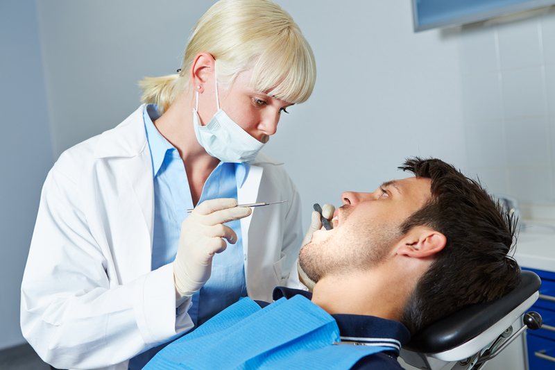 Photo of patient having a professional tooth-cleaning
