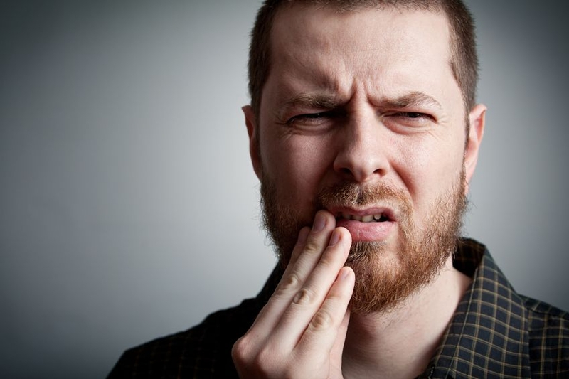 Photo of a man with toothache