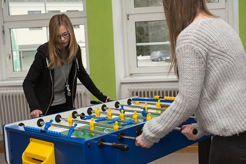 Photo of two teenage girls playing table football
