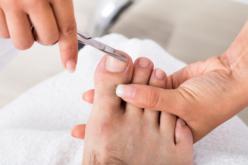 Photo of toenails being cut